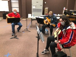 Melbourne students learn how to  play the guitar